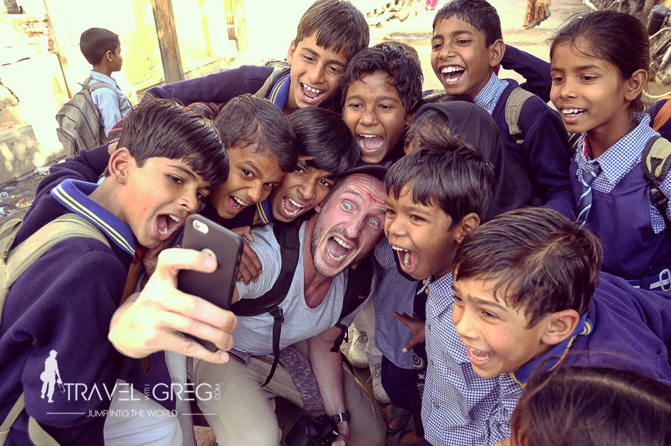 Participant of the travel photography workshop taking selfie with kids in Rajasthan.